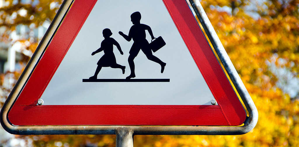 A road sign showing an outline of children at play can be quickly understood